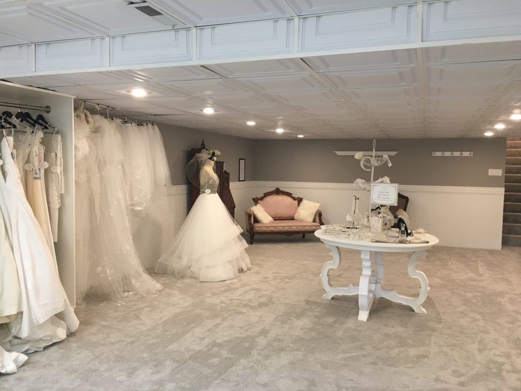10e7f50a1bb3b Dresses, Veils, Seating, and one of the Accessory Tables at New Name Bridal  Boutique in Wheaton